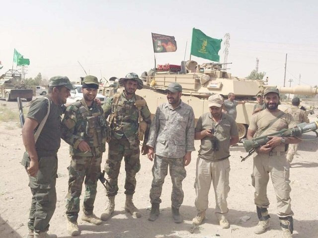 Badr Organization Fighters Pose with US M1 Abrams Tank