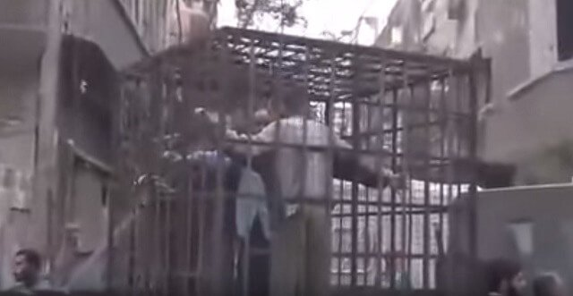Video: Caged Alawites as Human Shields to Deter Barrel Bombs
