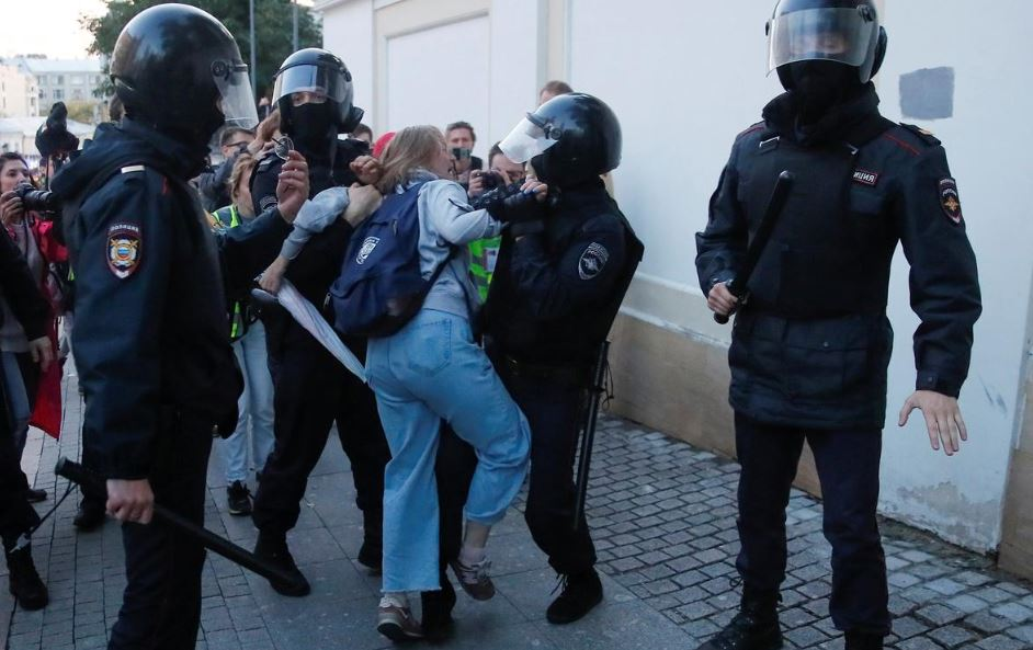As If Putin Punched A Woman Protester